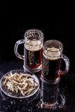 Beer and plate of anchovies Royalty Free Stock Images