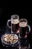 Beer and plate of anchovies Royalty Free Stock Photography