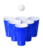 Beer pong. Blue plastic cups and ping pong ball isolated on white Royalty Free Stock Photography