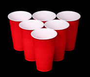 Beer pong. Red plastic cups over black Stock Photo