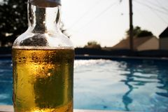 Beer on pool Stock Photo