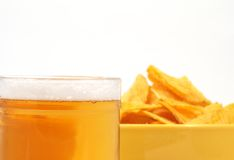 Beer and potato. Chips, focus on beer Stock Image