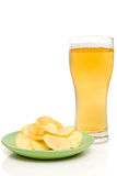 Beer and potato chips. Stock Image