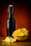 Beer and potato chips Royalty Free Stock Images