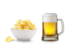 Beer and potato chips. Mug of beer and potato chips bowl isolated on a white background Stock Photo