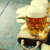 Beer and Potato Chips Stock Images