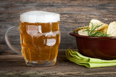 Beer and potato chips Royalty Free Stock Photo