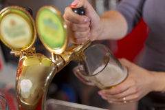 Beer is poured into a glass Royalty Free Stock Images