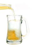 Beer poured into glass mug Stock Photos