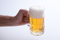 Beer poured into a mug Royalty Free Stock Photos