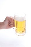 Beer poured into a mug Royalty Free Stock Images