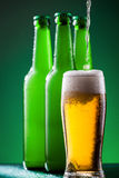 Beer pouring Stock Images
