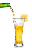 Beer Pouring From Bottle Into Glass Royalty Free Stock Photo