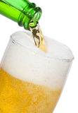 Beer is Pouring into glass Royalty Free Stock Photography