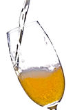 Beer pouring in glass. Against a white background Stock Photo