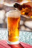 Beer pouring into glass Stock Photos