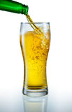 Beer is pouring into the glass Stock Image