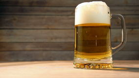 Pouring fresh beer in big glass stock video