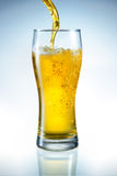 Beer is pouring into the glass Royalty Free Stock Photos
