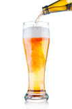Beer pouring into glass. Isolated on white background stock images
