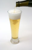 Beer, pouring lager. From a bottle into lager glass stock photos