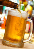 Beer pouring into mug royalty free stock photos