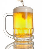 Beer pouring on mug Royalty Free Stock Image