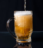 Beer pouring in a mug Stock Photo