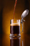 Beer pouring into mug Royalty Free Stock Images