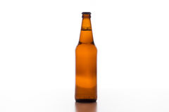 Beer pouring into mug. Isolate background Royalty Free Stock Images