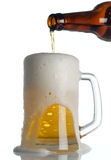 Beer is Pouring into mug on white Stock Photo
