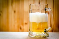 Beer pouring into mug Royalty Free Stock Photography