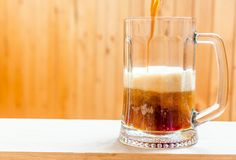 Beer pouring into mug Stock Images