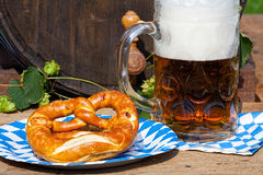 Beer and pretzel on a paper plate Stock Photography