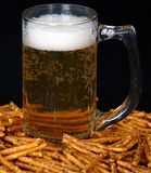 Beer and pretzels. A snack of beer and pretzels on a black background Stock Photography