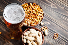 Beer with pretzels, saltsticks and peanuts. Viewed from above with copyspace. Stock Photos