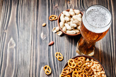 Beer with pretzels, saltsticks and peanuts. Viewed from above with copyspace. Stock Photography