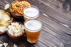 Beer with pretzels, saltsticks and potato chips. Viewed from above. Royalty Free Stock Photos
