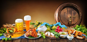 Oktoberfest. Beer, pretzels and various Bavarian specialties. Oktoberfest background stock image