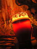 Beer in the pub. Pint of beer with foam in the evening Royalty Free Stock Photos