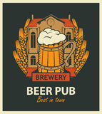 Beer pub label with brewery building and beer mug. Template vector beer pub label with brewery building, a mug of beer and wheat wreath in retro style Royalty Free Stock Images