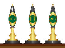 Beer Pumps. A set of three traditional and typical beer pumps with beer type signs Stock Photos