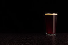 The beer red ale. The dark background Royalty Free Stock Image