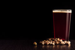 The beer red ale and snacks. Stock Image