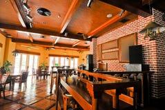 Beer restaurant indoor with wooden furniture royalty free stock image
