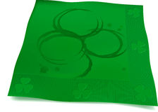 Beer Ring Shamrock Napkin. Shamrock made from beer bottle rings on beverage napkin Royalty Free Stock Photography