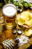 Beer rustic style . Beer and chips stock photography