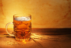 Beer on sacking. With wheat still-life stock photo