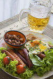 Beer with salami appetiser Royalty Free Stock Images