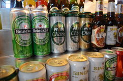 Beer for sale. Assorted beer bottles and cans for sale Royalty Free Stock Photo